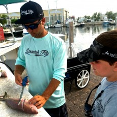 Chris Mendola gives Darrell the 411 on properly filleting a fish.