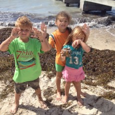 Bryson, Rylee, and Skyler cleaning up Smathers Beach